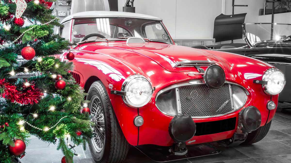 Austin-Healey 3000 rally spec next to a Christmas tree.