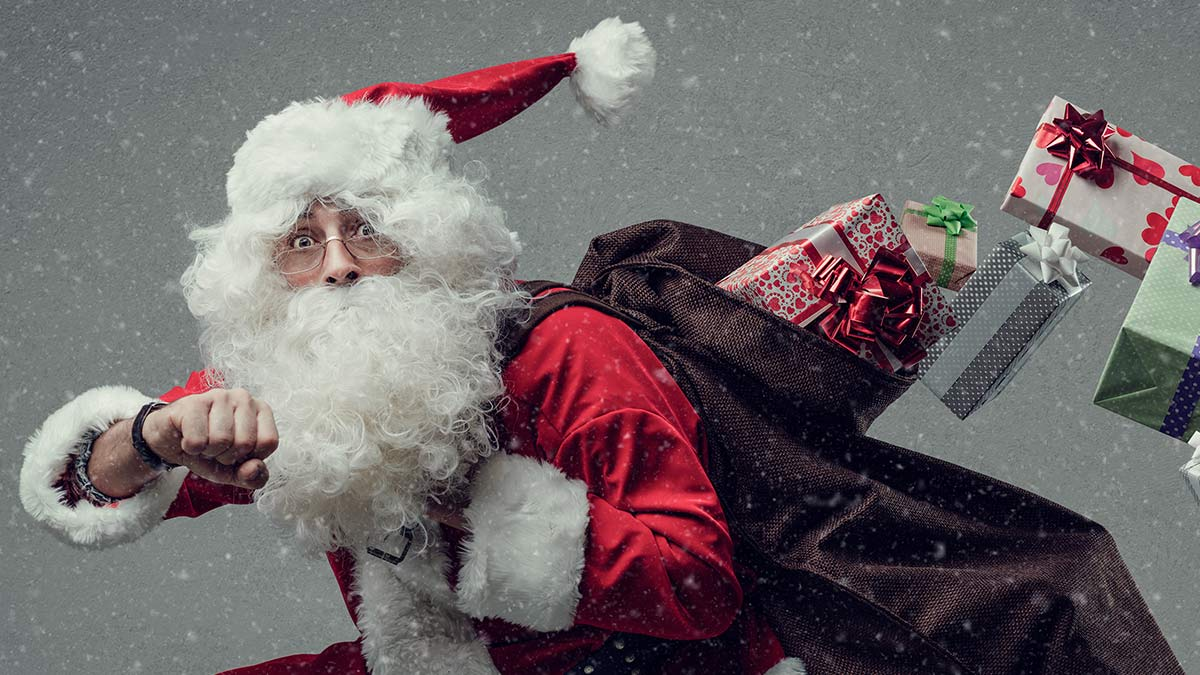 Santa Claus rushing to deliver presents.