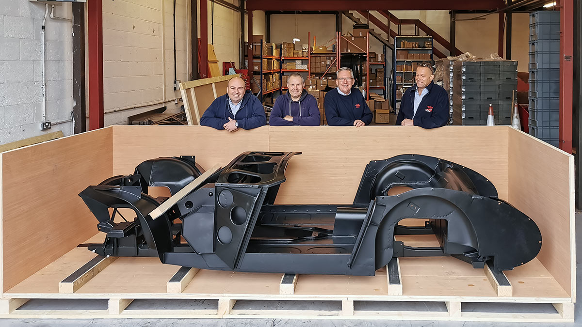 A H Spares Management team with complete Austin Healey BT7 centre-change inner body substructure in its custom made shipping crate.