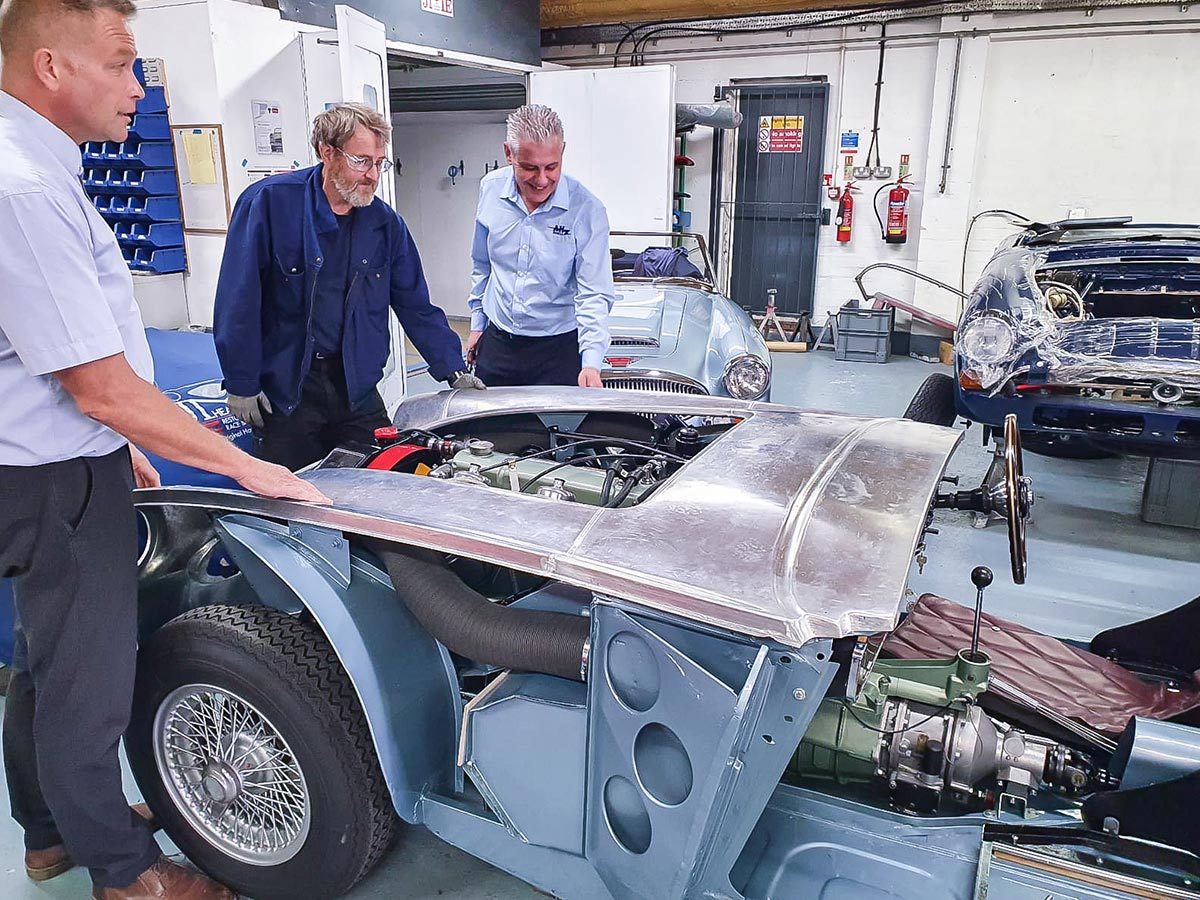 John Lee, Mark Style and Mark Friel overseeing the test fit of A H Spares new Austin Healey outer body shell at JME Healeys