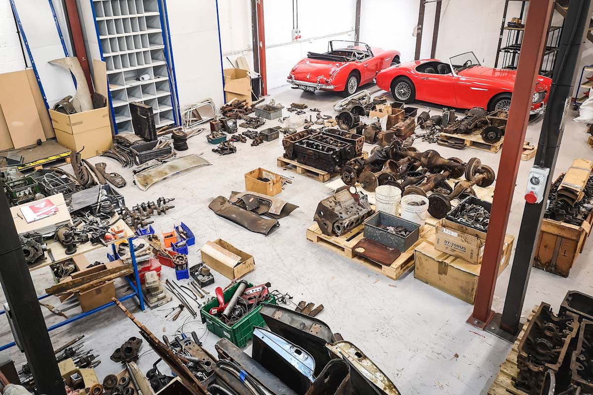 Second hand Austin Healey parts laid out on the workshop floor