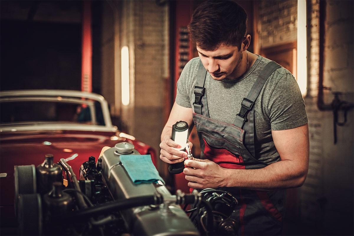 Mechanic inspecting Austin Healey engine