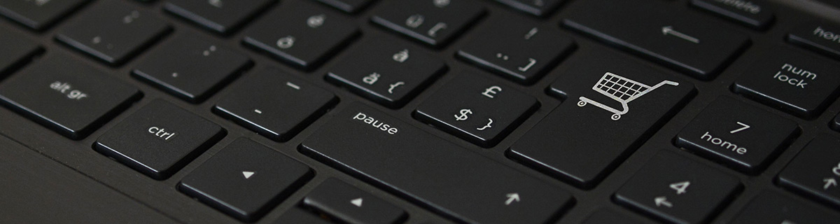 Black keyboard with shopping trolly icon.