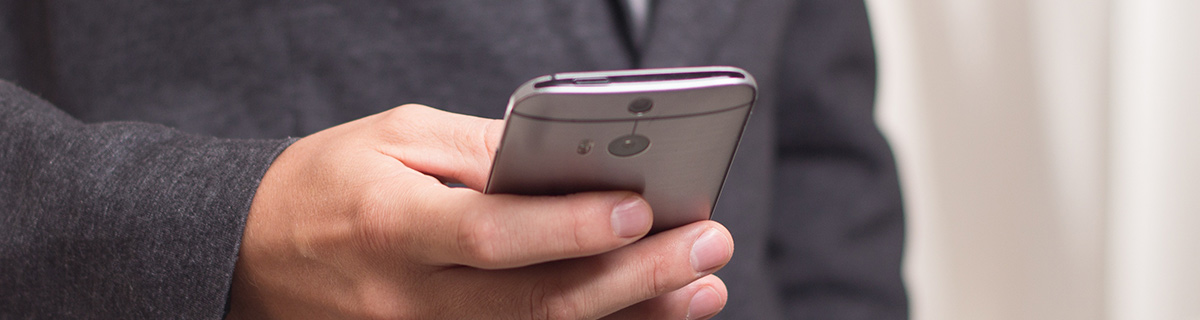 Image of a man browsing on a mobile phone.