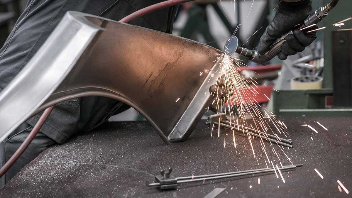Image of grinding Austin-Healey outer body panel