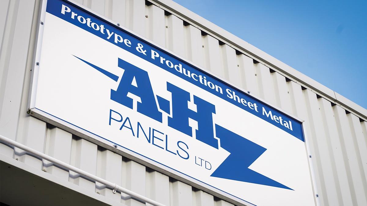 Image A.H Panels shop sign