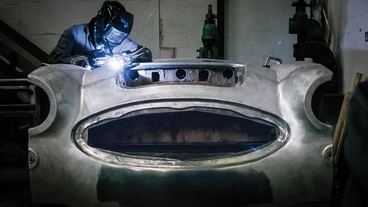 A.H. Panels craftsman welding an Austin-Healey aluminium front shroud.