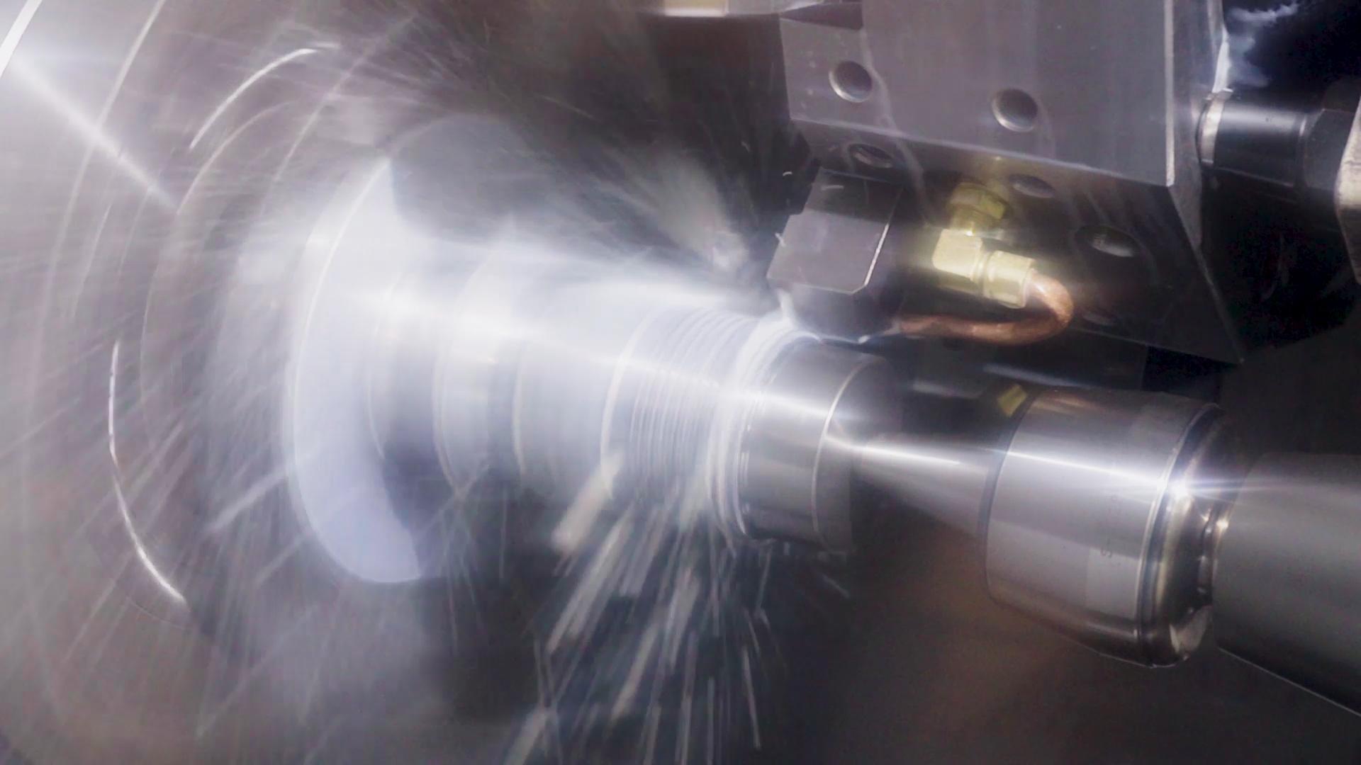 Screenshot from corporate film. CNC machining Austin-Healey wheel hubs.