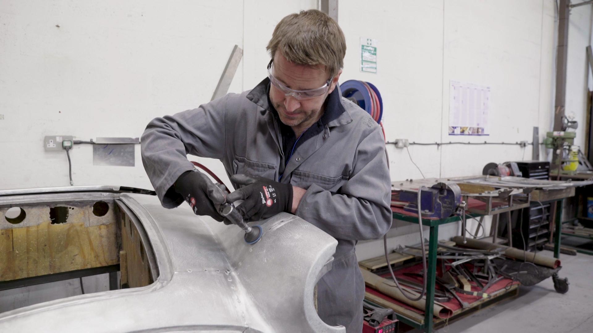 Screenshot from corporate film. Working on aluminium Austin Healey shroud
