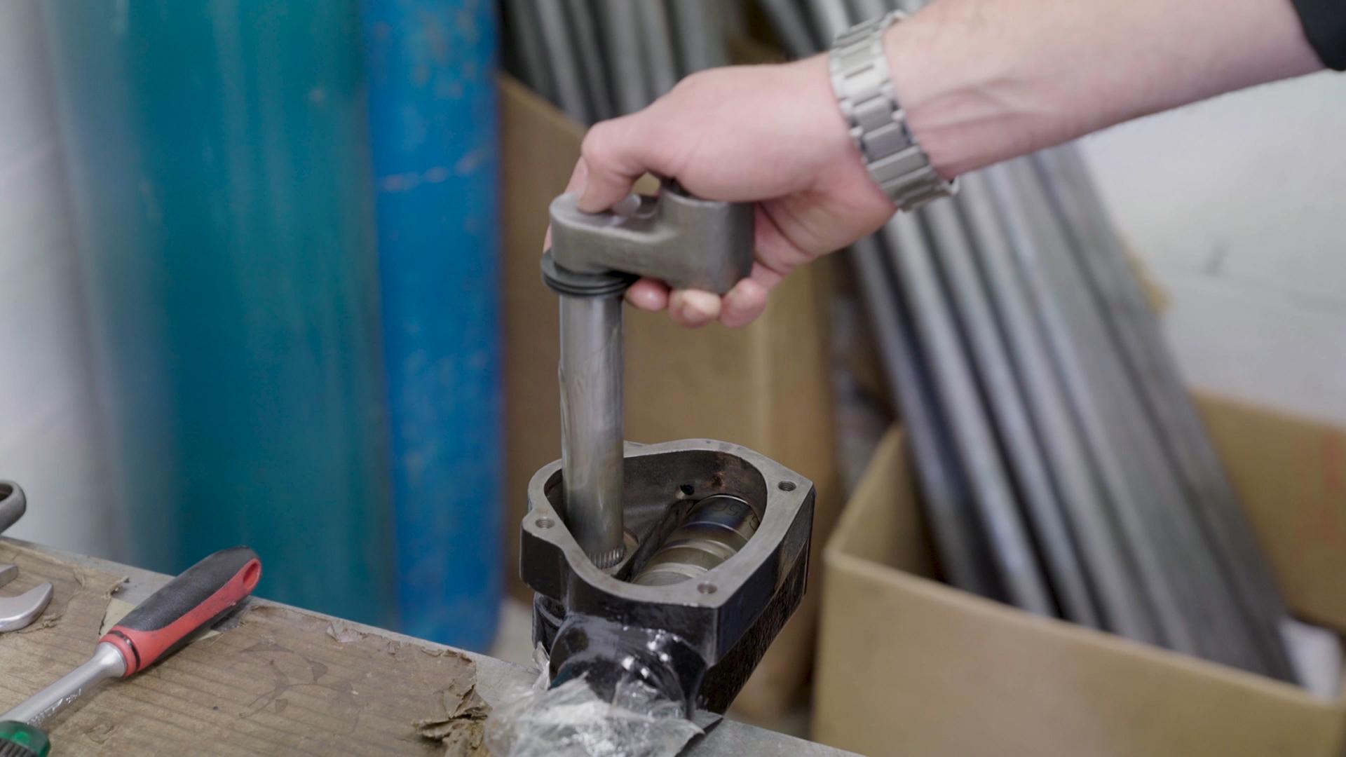 Screenshot from corporate film. Assembling Austin-Healey steering box.