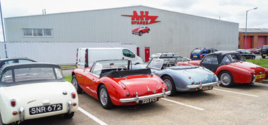 Image of four Austin-Healeys parked outside A.H. Spares Ltd