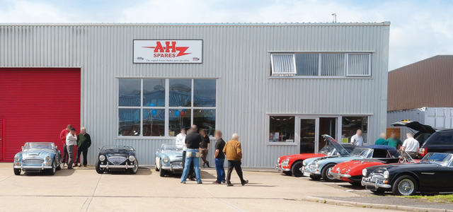 Image of 7 Austin Healeys outside A H Spares