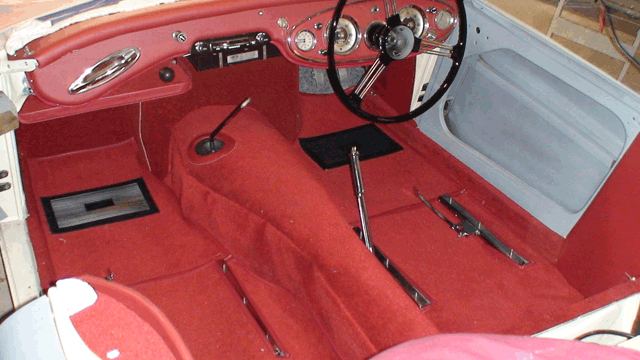 Image of Austin Healey 100/6 with new red carpet interior