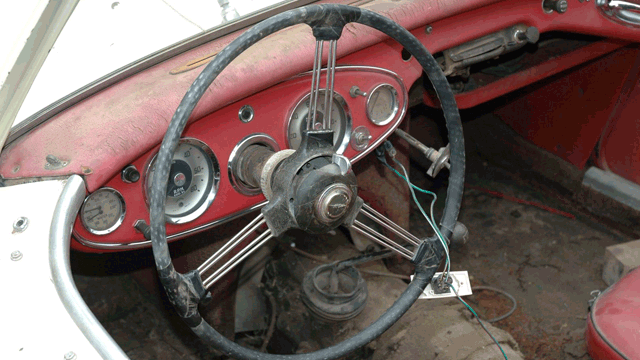 Image of an unrestored steering wheel in an Austin Healey 100/6