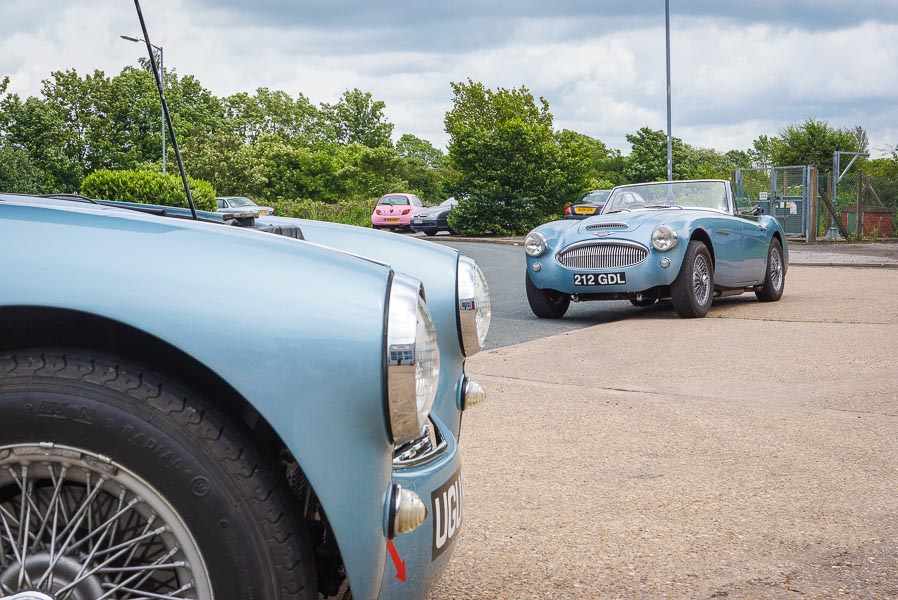 Image of two blue Austin-Healeys parked outside A.H. Spares during the 40th anniversay open day.