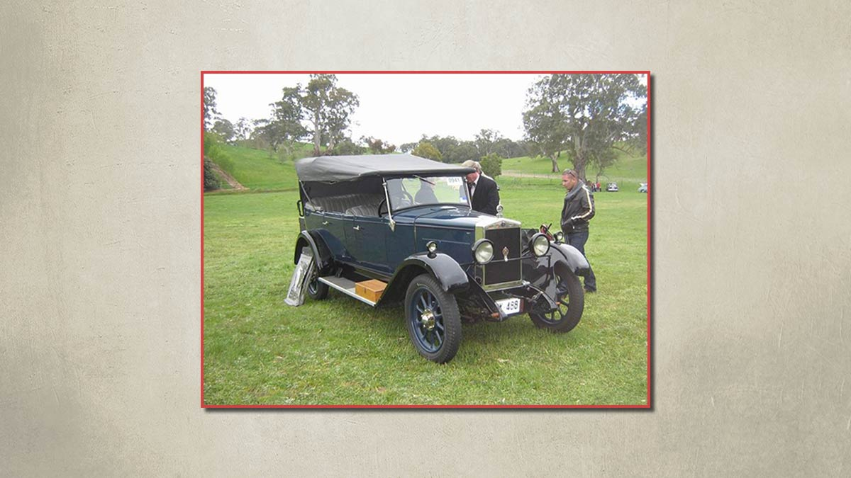 1923 Overland vintage car parked on grass.