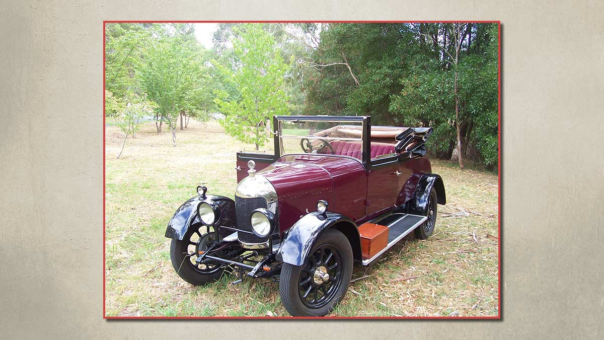 Open top burgandy 1928 Bullose Oxford vintage car.