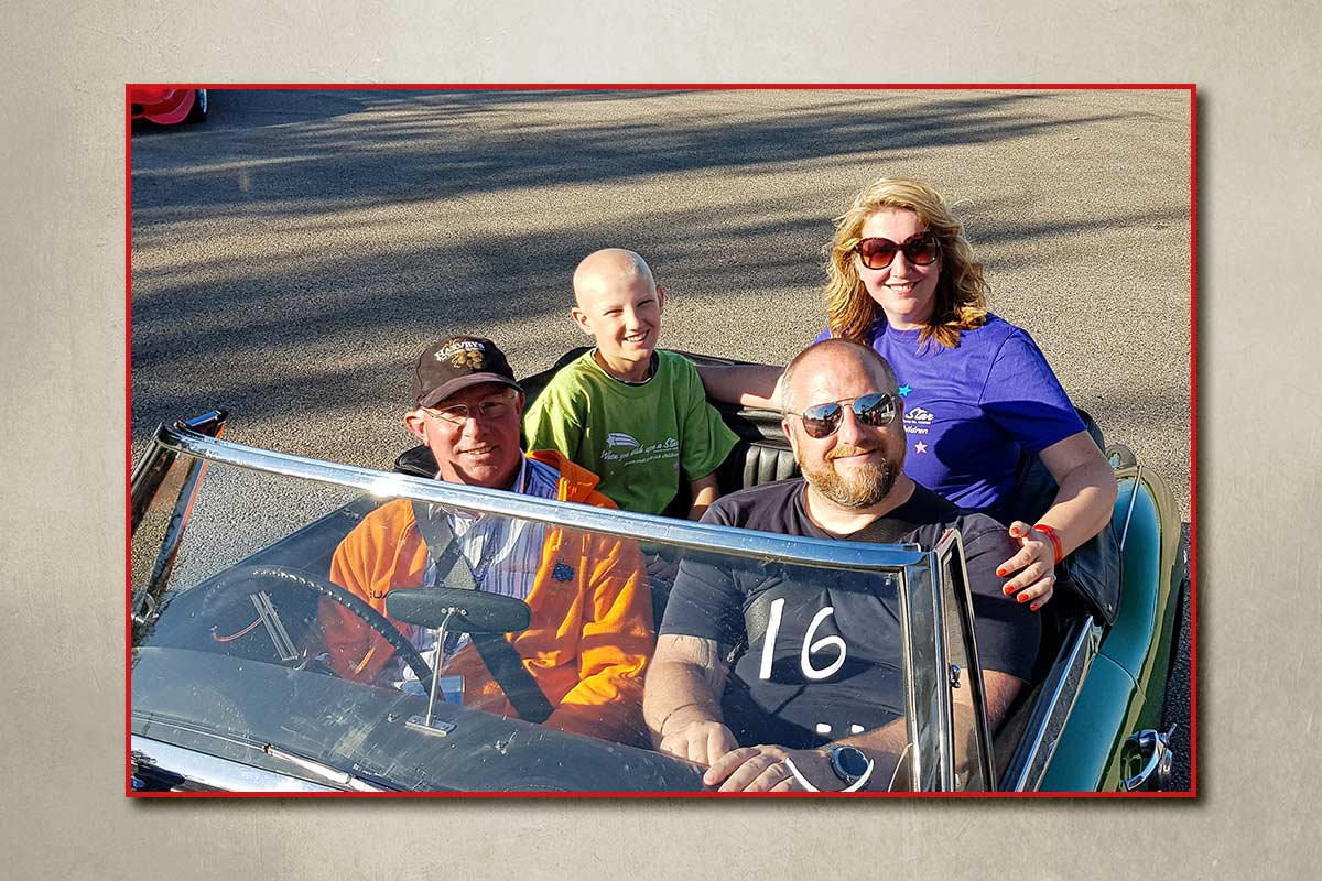 Steve Ormerod in his Austin Healey 3000 with a family