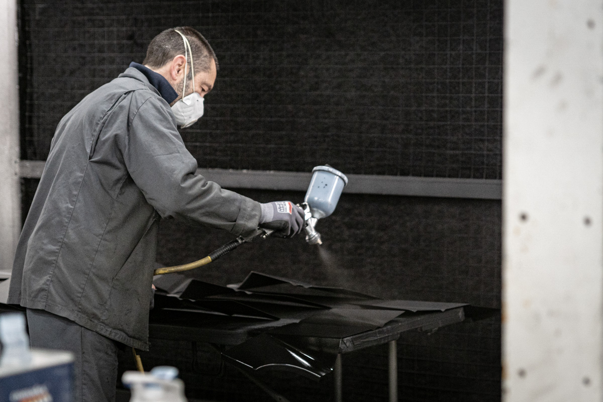 Steel Austin Healey panels spray-painted black to protect against corrosion.