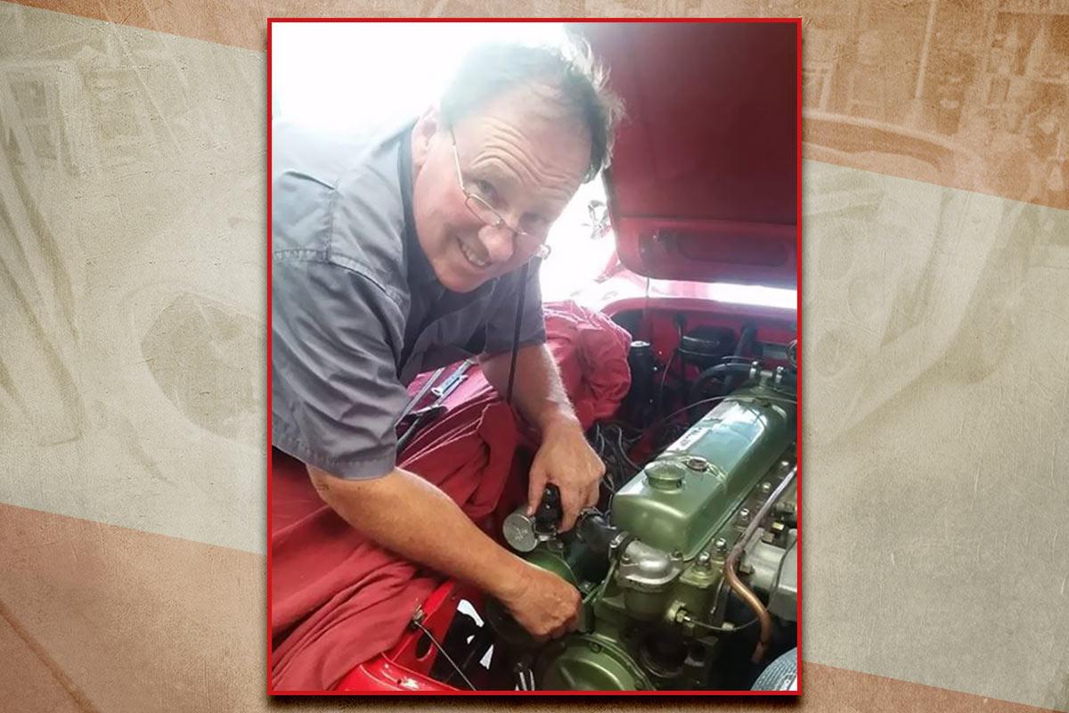 Greg Barnsley working on his Austin Healey 100/6 engine.