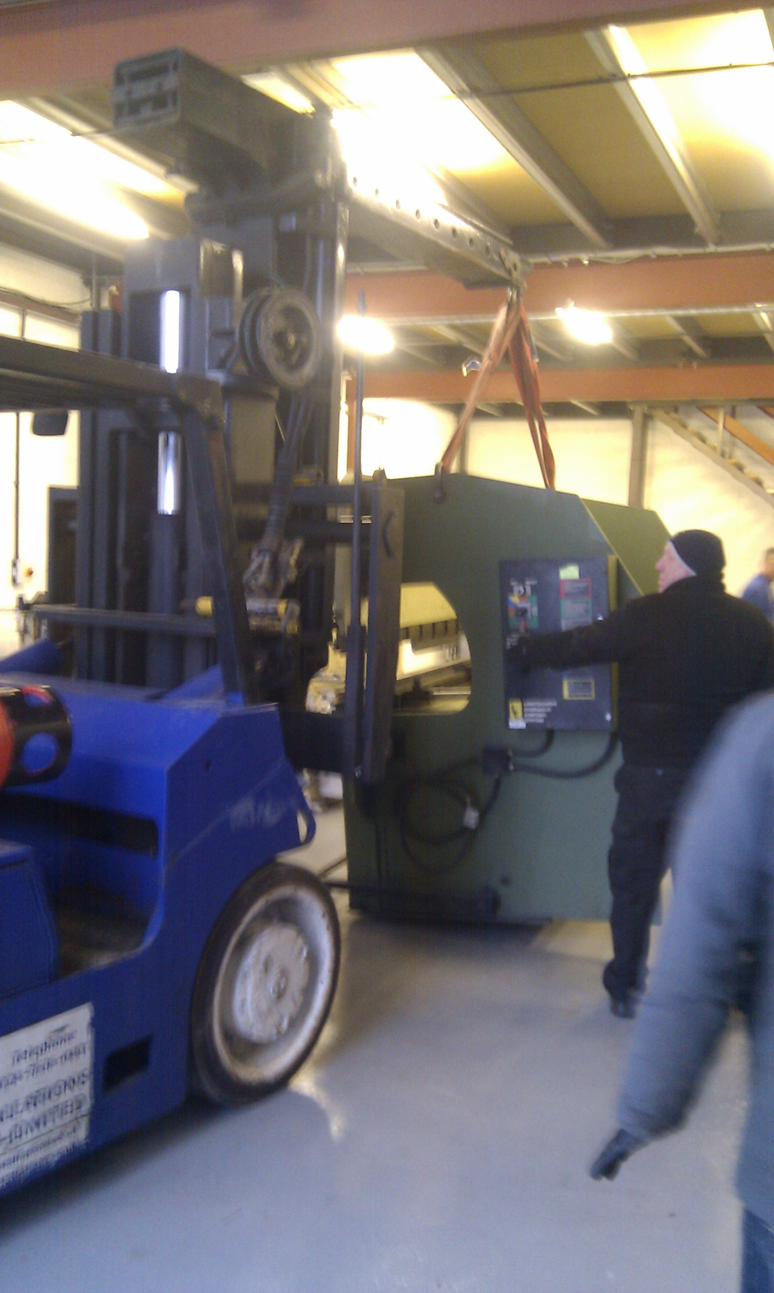 Moving the machinery into the new unit.