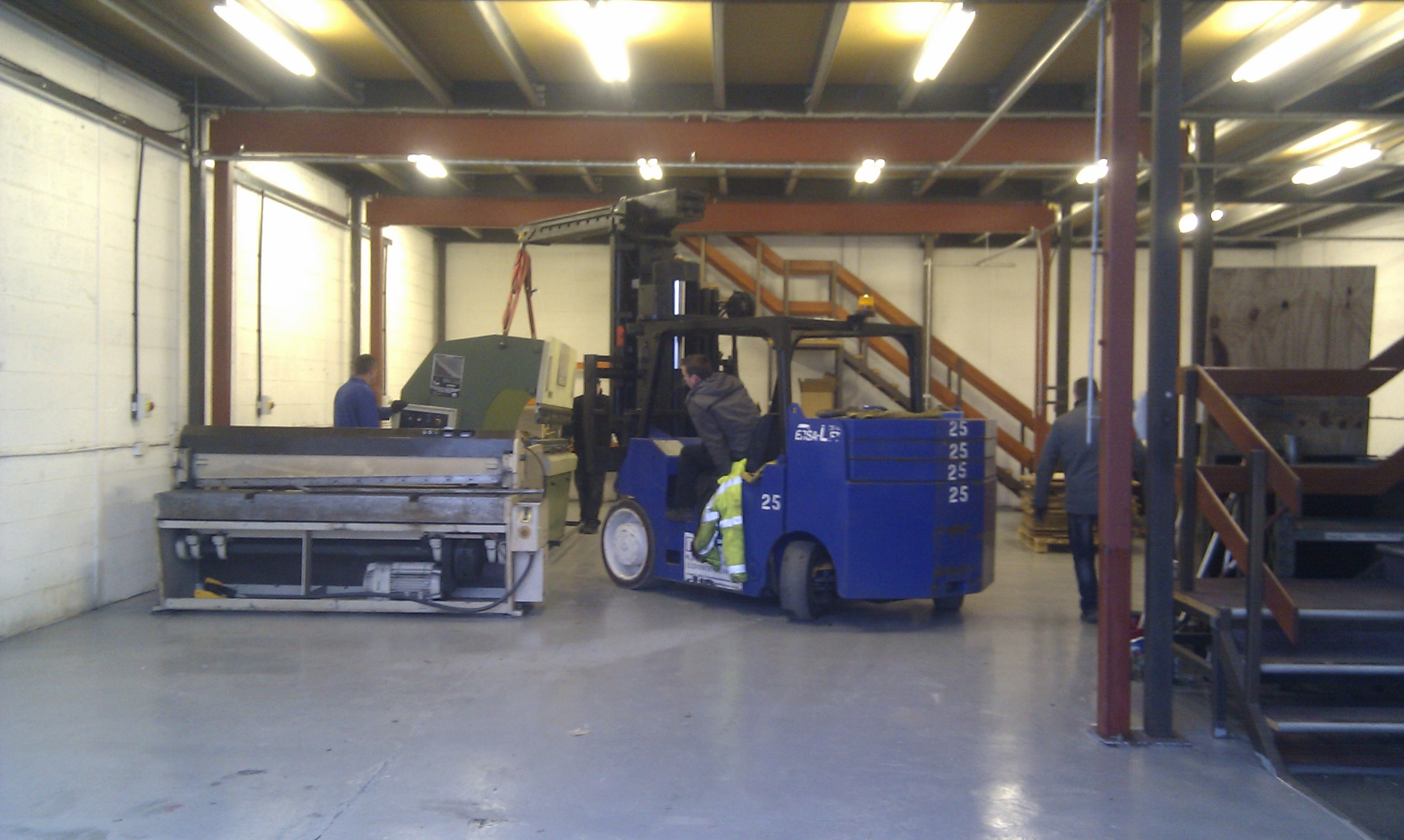 Moving the machinery into the new location.