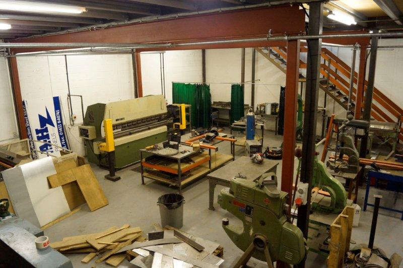 Setting up the machinery and organising the stores.